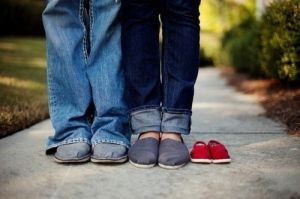 We're adding TWO more feet to make our family Complete! Another baby is on the way and expected in late May.