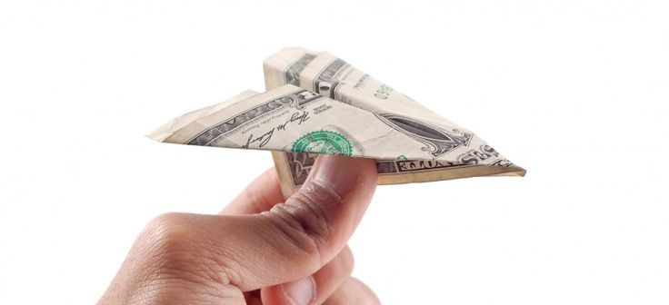 Cheap Air Fare Expenses With Paper Plane Made Of Cash And A Man About To Throw It.