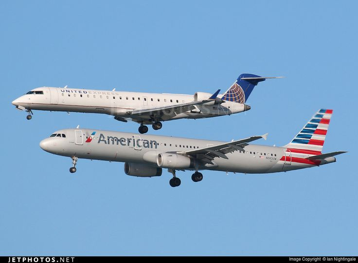 United Express (SkyWest Airlines)  Bombardier CRJ-701 N773SK c/n 10236 & American Airlines Airbus A-321-231 N583UW c/n 6181 San Francisco Int'l September 18, 2016 Photo by: Ian Nightingale