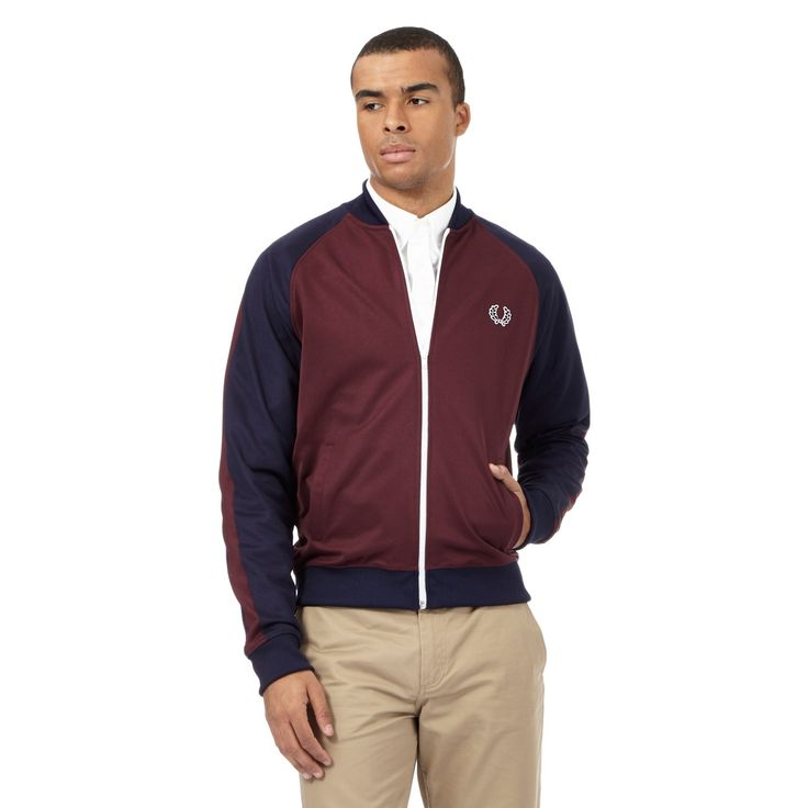 From Fred Perry, this jacket is an essential layering piece for off-duty style. In a rich dark red hue with navy sleeves, this staple piece features a signature logo embroidery at the chest and has been designed with a ribbed funnel neck. Team with a tee and denim for a classic daytime look.