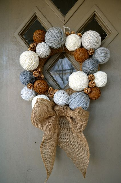 DIY yarn ball wreath, mostly because it could solve small apartment storage problems :D