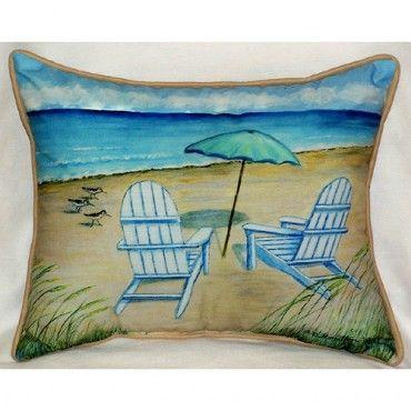 Adirondack beach chair, sitting serenely beside the sea. #coastalpillow #mothersdaygift