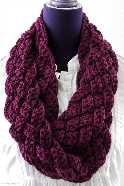 This woven crochet cowl has a braided look, perfect for anyone who wants a chunky, cozy cowl for winter