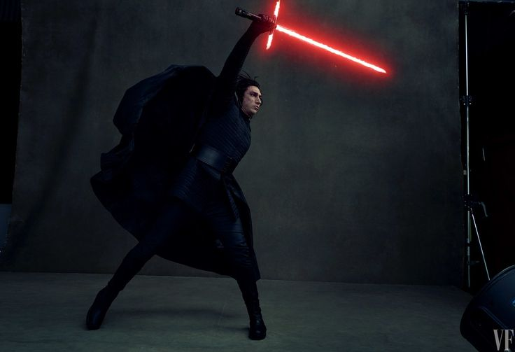 Spawn Adam Driver, in character as Kylo Ren, Han Solo's son and slayer, wields a crossguard lightsaber.