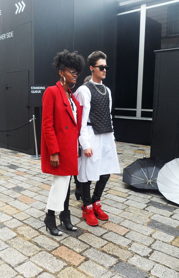 Flash of Red #red #black #white #london #fashionweek #coat #womenswear #menswear #sunglasses #pair
