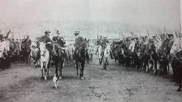 British POWs guarded by Boer soldiers.
