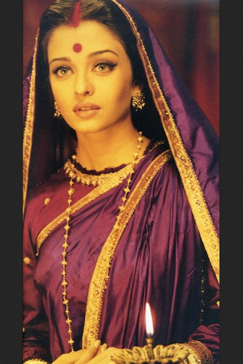 Very traditional look by #aishwarya rai in #devdas. good color combination of gold and purple or violet. http://www.shaadiekhas.com/