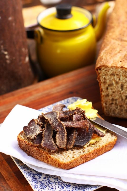 Home made whole wheat bread with butter and biltong