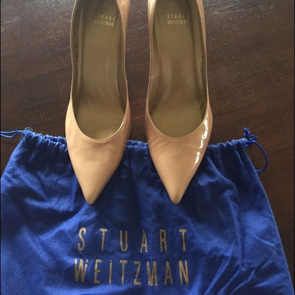 Stuart Weitzman Neutral Pumps Elegant Stuart Weitzman pump. Neutral color with an elegant heel. Patent material, but not overly shiny. They do run a little small, feel like a 9 rather than an 8 1/2. Hardly worn, a little too high for me. Really great condition. Stuart Weitzman Shoes Heels