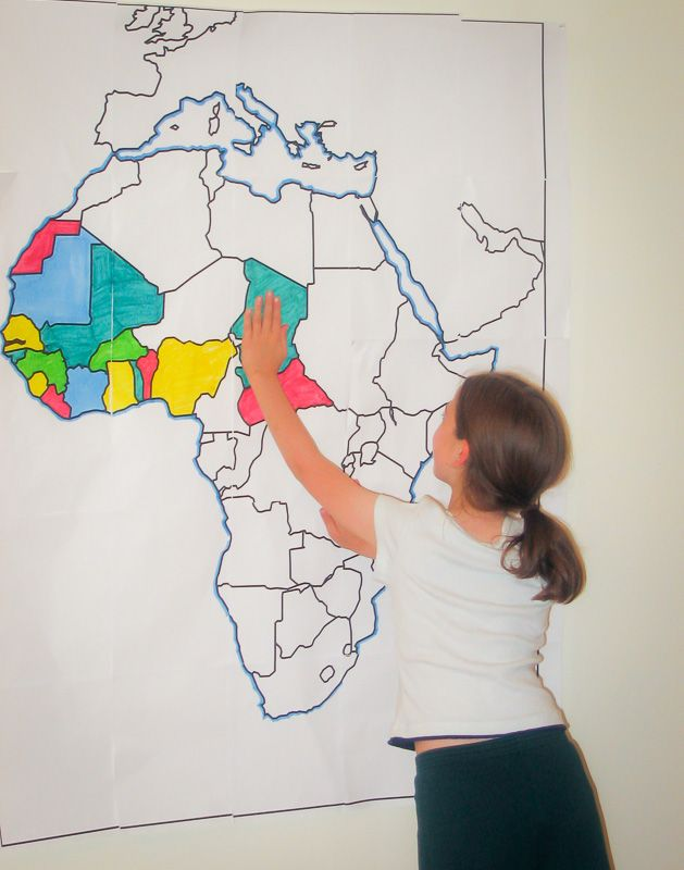 Finding countries of Africa on a large wall map of Africa.