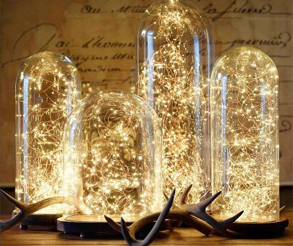 What's a fairy tale wedding without some fairies? Hurricane candle holders and display cases trap fairy lights for an enchantment beyond roses.