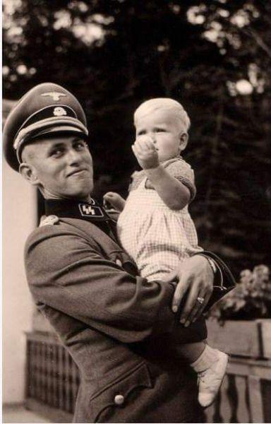 SS-Obersturmführer Hans-Jörg Hartmann photographed with his daughter in 1941…