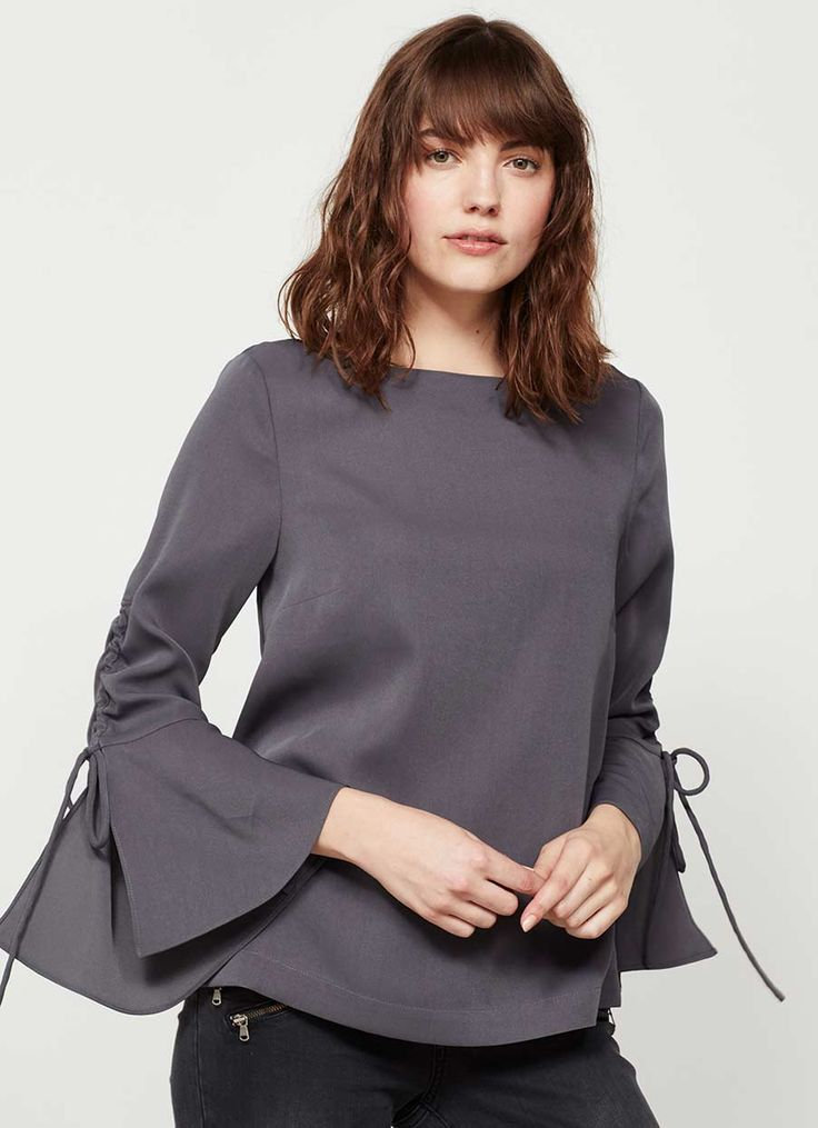 Web Exclusive - Simple, yet elegant, steel fluted sleeve blouse. In a boxy shape, perfect for the season ahead. Model is 5'10in and wears a UK size 10.The length from side neck point to front hem measures 62cm/24.5in.