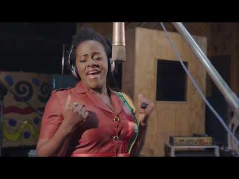 Etana - Reggae [Official Music Video] HD To me, this song truly embodies the essence of reggae! What an incredible voice Etana has too! Every time I listen to this, I'm torn between wanting a Red Stripe or a Ting!
