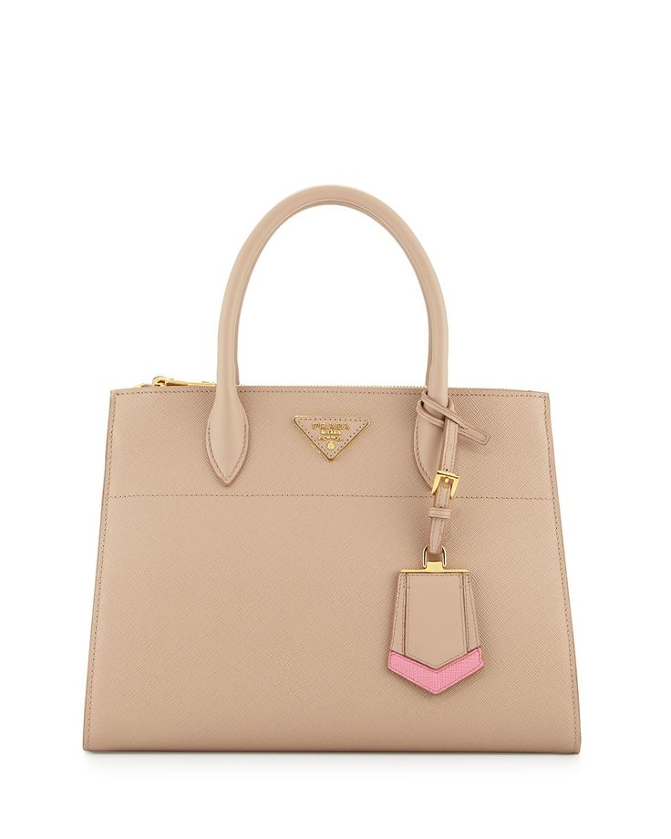 """Prada saffiano leather tote bag with chevron trim. Available in multiple colors. Rolled top handles with hanging luggage tag, 4.7"""" drop. Removable shoulder strap, 16"""" drop. Open top; front and back zi"""