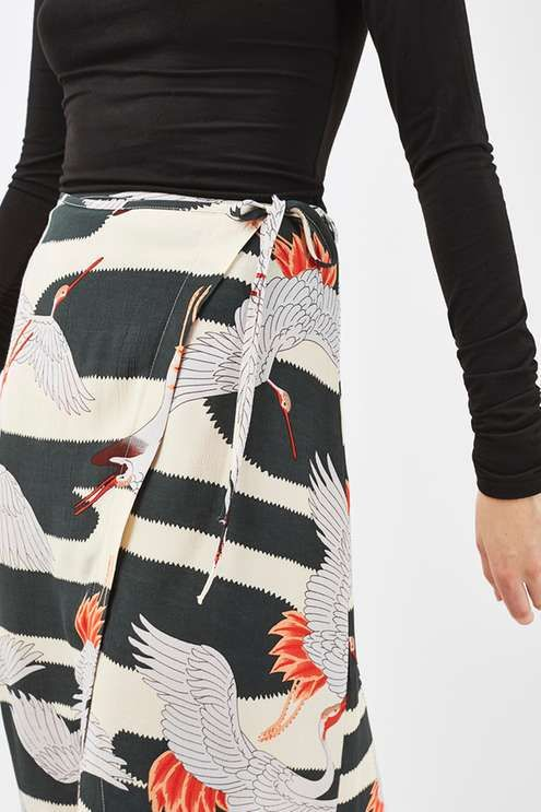 Opt for quirky details to mix up your wardrobe. This woven midi skirt comes with a trending wrap-over detail and is finished in all-over heron print. A perfect match with a funnel neck black knit. A chic way to add character to your look. #Topshop