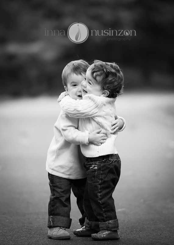 twin toddlers hugging