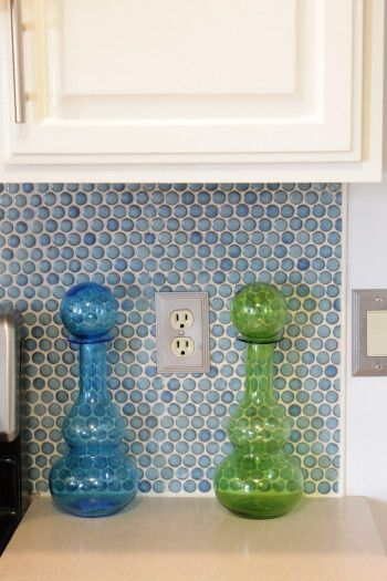 Tile edging solution: tiny quarter-round wood trim! painted same color as cabinets
