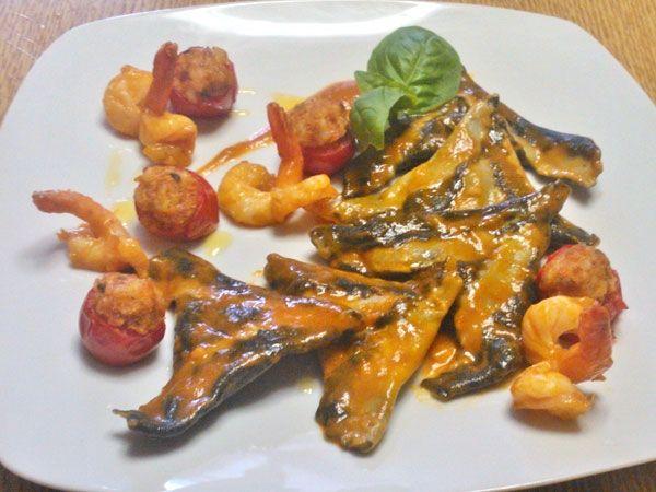 Ravioli di branzino mantecato con pomodorini, ripieno di gamberi , ricetta inserita da Stefano Pighi