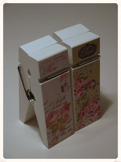 A pack of two freestanding oversized floral pegs one in a pastel green colour and the other in a pastel pink purple These pegs could be used for