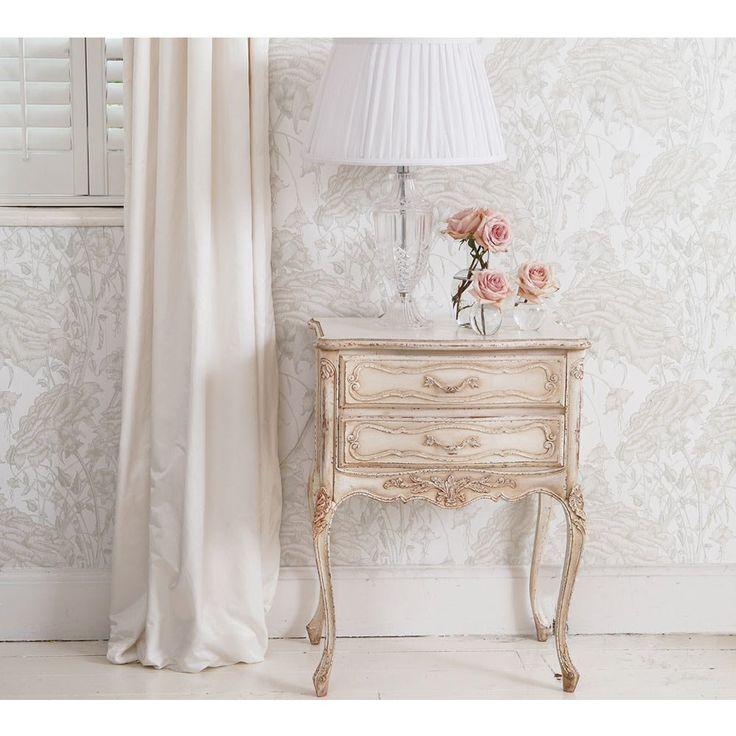 Delphine Distressed French Bedside Table by The French Bedroom Company is at the same time feminine, romantic and shabby chic.