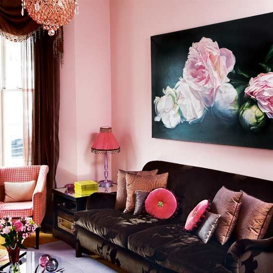 The painting is by Thomas Darnell, and the walls are painted in Papers and Paints' 8-090 Pink. The sofa is covered in velvet from Abbott & Boyd. For similar square cushions, see the Biba ones at House of Fraser.