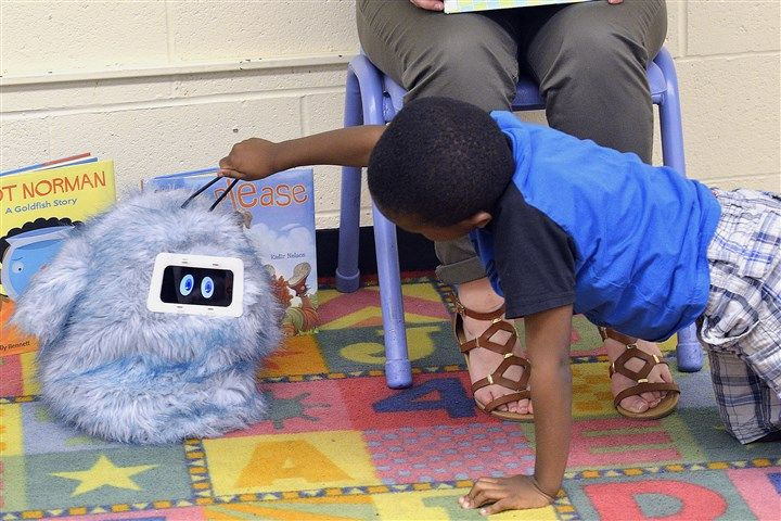 "Robots aren't normally thought of as social butterflies. But a growing number of children, including some in Pittsburgh, are seeing their social skills soar with the help of Romibo — a small, fuzzy robot. Romibo is a social therapy robot created by Aubrey Shick, who has a master's degree in human computer interaction from Carnegie Mellon University, and Garth Zeglin, who has a Ph.D. in robotics from CMU. The name, Romibo, was chosen because it sounds like the words ""robot for me,"" Ms. Shick…"