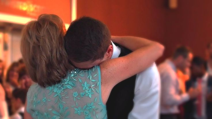 Groom Cries in His Mother's Arms at Wedding