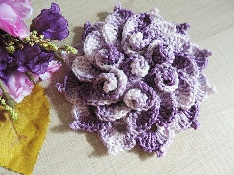 Such a pretty crochet flower, & great tutorial! It's in some form of Spanish, and the actual tutorial it's self is a video.