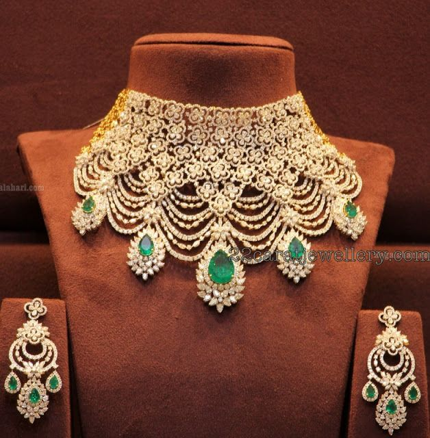 Tremendous Trendy Diamond Necklace 18 carat gold tremendous necklace in latest style, Nice brilliant cut diamonds adorned simple flower motifs placed all over the necklace and diamonds tassels with attractive emeralds clasps hanging all over the bottom. Teamed up with opulent diamond earrings