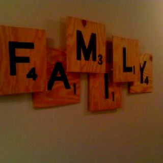 Fun family room idea. I can do this with the free wood flooring samples at home depot !!