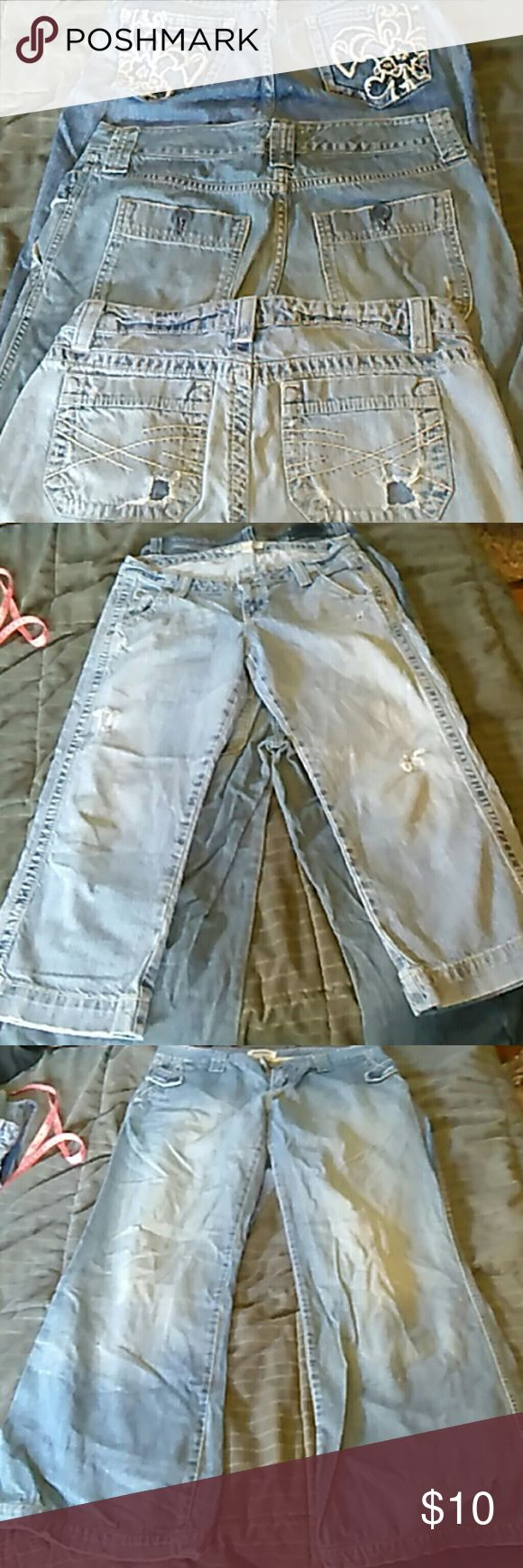 3 pairs jeans Aero Capri distressed size 7/8 light wear. Abercrombie and Fitch wide leg Jean trousers size 8. Broken button on back pocket. Red River size 7 Capri. Light stretching in thigh area. Abercrombie & Fitch Jeans