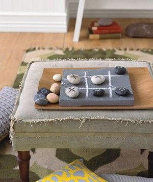 Rocks as Tic-Tac-Toe Game.  Will make and leave outside on the side table by the lounge chairs by the pool.  Paint X's and O's on top of small stones and draw a grid on any square surface.