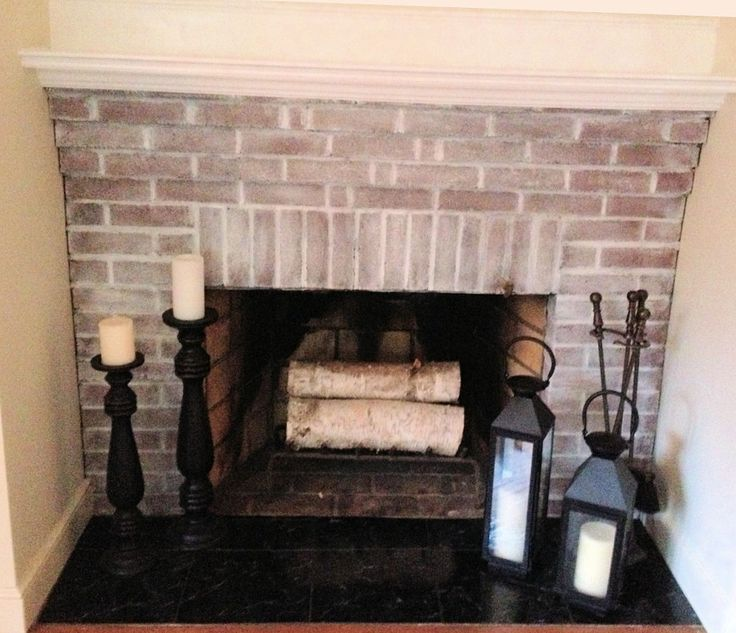 white wash fireplace with peel and stick floor tile