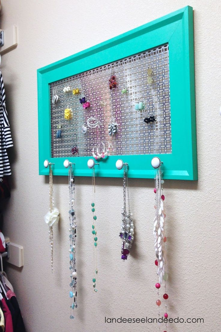 Make this DIY Jewelry Organizer to help keep your necklaces and earrings all in plain sight while also being so pretty! Customize it for any space!