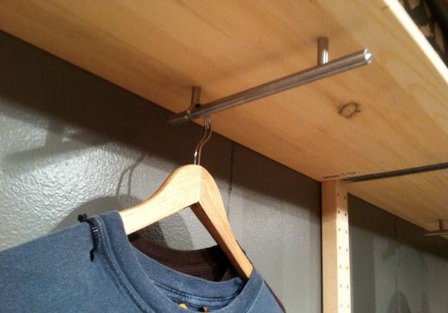 This is a great idea for the laundry area, to hang up extra hangers and hang clothes straight from dryer.