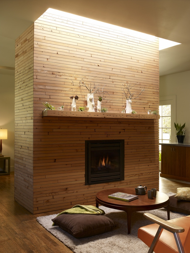 Front hearth fireplace with skylight above that illuminates mantel with natural light. Further Ideas: Have skylight wrap around the entire freestanding chimney.