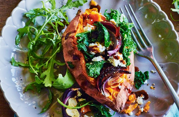Stuff sweet potatoes with kale, spices & feta cheese before baking until the jackets crisp up. Find this easy sweet potato recipe & more at Tesco Real Food.