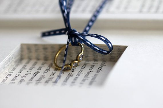 This would be the most adorable way to hide a ring for a book nerd like myself!