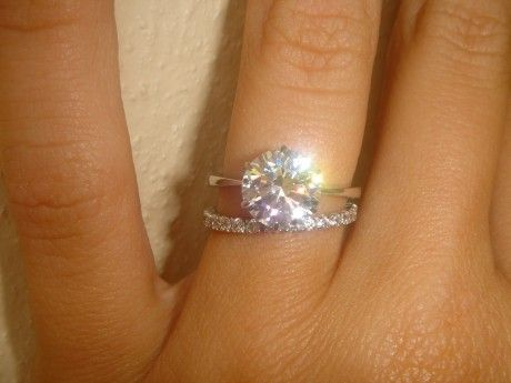 Dream setting!  Thin dainty band, with super sparkly center stone (6 prong basket setting) and eternity band!