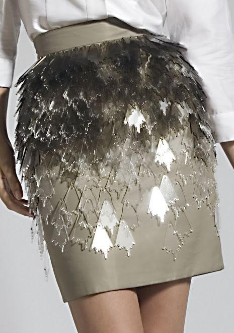 Skirt with clear acrylic embellishments using repeating shapes, layered up to create texture; fashion details // Joanna Vanderpuije