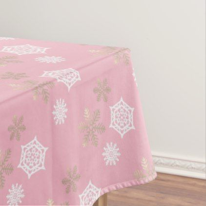 golden and white snowflakes against pale pink tablecloth - winter gifts style special unique gift ideas