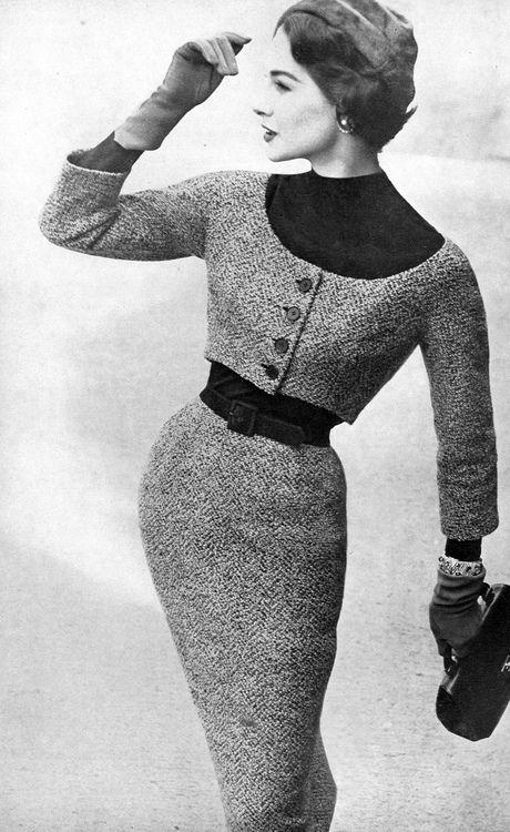 Model in tweed dress with matching short jacket, Vogue US, August 15, 1954. Narrow waist and long skirt.