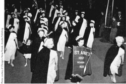 St. Anne's Hospital School of Nursing students march in the Chicago Nurses Day Parade of 1949. One of their floats had to be trimmed down when it wouldn't fit under a viaduct before getting to the parade route.