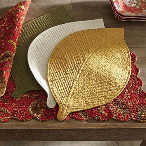 Add a unique touch to your dining area with table linens that celebrate this unique time of year. Rich colors and patterns that reflect the seasonal elements of falling leaves and bountiful harvest always look perfect at your dining table. Take it one step further and add a tablescape. Start with a table runner, then add seasonal elements, like small pumpkins and a scattering of colorful leaves. Finish with several tea lights.