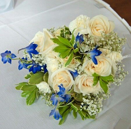 pretty bouquet features cream roses white carnations baby 39 s breath blue delphinium green. Black Bedroom Furniture Sets. Home Design Ideas