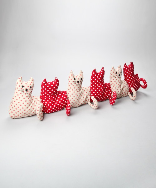 Keep the draft out and the cuteness in with this multi-kitty draft excluder! A great addition to any home.Cotton liner filled with sandImported