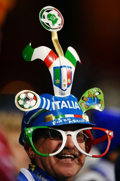 An Italy fan wearing a makarapa helmet and oversize glasses  enjoys the atmosphere prior to the 2010 FIFA World Cup South Africa Group F mat...