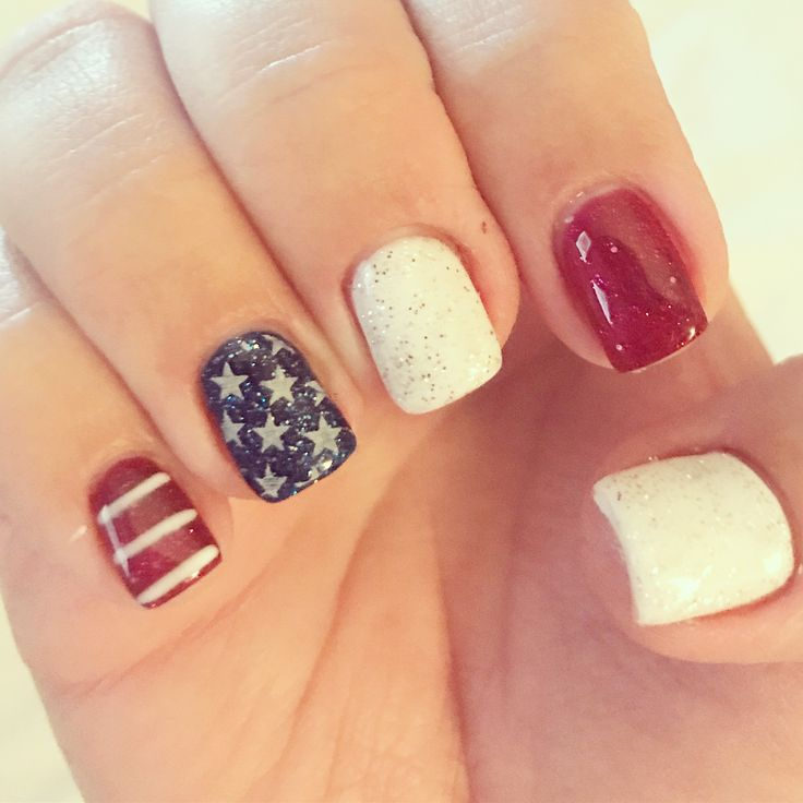 Fourth of July nails. 4th of July nails. Patriotic nails. American flag nails. Gel nails. Red white and blue nails. Star nails. Stripe nails. Natural nails. Square nails. Glitter nails