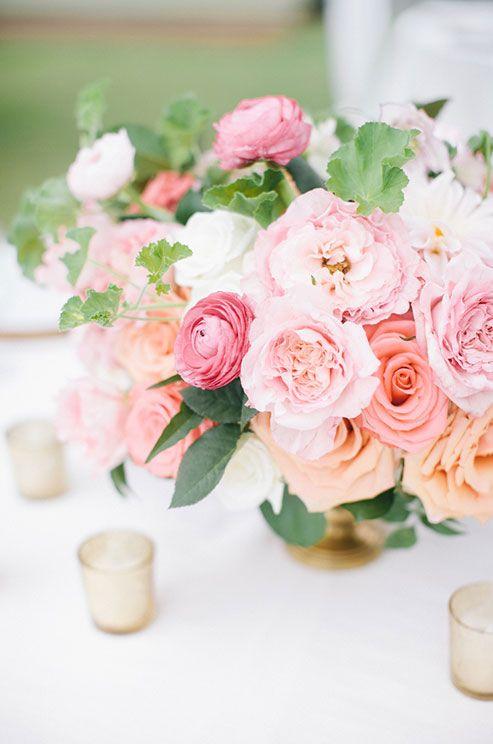 Pink and green floral arrangements add freshness to a beautiful summer garden wedding.
